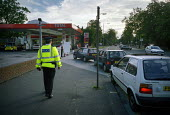 Police presence at a petrol station in Manchester during the fuel crisis, to allow only essential service employees to buy fuel. The shortages were caused by lorry drivers and farmers blockades in pro... - Paul Herrmann - 14-09-2000