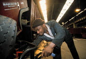 A mechanic working on a Manchester City Council dustcart - Paul Herrmann - 16-11-2000