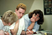Adult education Basic Skills course lecturer helping students to learning to read, write and numeracy. Organised by CATU trades union Stoke on Trent - John Harris - 02-02-2000