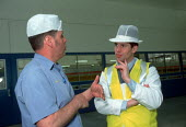 Worker discussing production with manager at a highly automated production line at a cardboard manufacturing and printworks. - John Harris - 23-03-2000