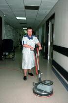 Hospital cleaner polishing the floor. - John Harris - 04-04-2000