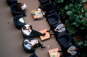 BT office workers relaxing during a break. Brindley Place. Birmingham. - John Harris - 2000,2000s,BAME,BAMEs,black,BME,bmes,book,books,break,Brindley Place,Brindleyplace,business,cities,city,coffee,cup of,DINNER,dinners,DINNERTIME,diversity,ebf,Economic,economy,ethnic,ethnicity,job,jobs