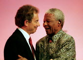 Nelson Mandela ANC greeting Tony Blair MP Labour Party Conference 2000. - John Harris - 2000,2000s,BAME,BAMEs,black,BME,bmes,Conference,conferences,diversity,ethnic,ethnicity,greeting,minorities,minority,Party,people,poc,POL politics