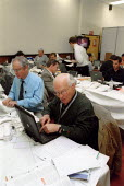 Journalists writing stories on their laptop computers in the Press room, TUC conference 2002 - John Harris - 12-09-2002