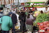 Muslim women shopping. Sparkbrook Birmingham. - John Harris - 2000s,2001,asian,black,BME black,bought,british Muslim,british Muslims,burkha,buy,buyer,buyers,buying,cityscape,cityscapes,commodities,commodity,consumer,consumers,customer,customers,dress,EBF economy
