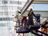 Construction workers placing girders. Redevelopment of the Bull Ring, city centre Birmingham. The Rotunda. - John Harris - 18-10-2001