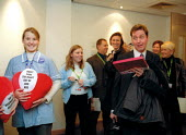 Unison student nurses presenting a box of chocolates, don't take the heart of our NHS to Alan Milburn MP in protest at NHS policy. Labour Spring Conference Cardiff - John Harris - 02-02-2002