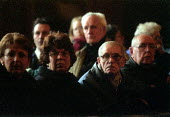 Retired miners, widows and family at an NUM meeting to draw attention to the delay in compensation for occupational diseases contracted whilst mining coal. Typically vibration white finger, and lung d... - John Harris - 21-02-2002