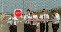 Group 4 security guards watch anti deportation protest at Yarls Wood Detention Centre. Bedfordshire - John Harris - ,2000s,2002,activist,activists,Asylum Seeker,Asylum Seekers,Asylum Seeker,Asylum Seekers,CAMPAIGN,campaigner,campaigners,CAMPAIGNING,CAMPAIGNS,center,centre,clj,DEMONSTRATING,DEMONSTRATION,DEMONSTRATI