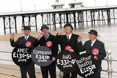 Fat Cat businessmen on Blackpool's promenade at the GMB General Secretary John Edmonds called on the Prime Minister to condem the Privatisation Pay Pirates involved in the Government's PFI initiative.... - John Harris - 2000s,2002,activist,activists,Bowler Hats,CAMPAIGN,campaigner,campaigners,CAMPAIGNING,CAMPAIGNS,capitalism,capitalist,cats,cigar,conference,conferences,DEMONSTRATING,DEMONSTRATION,DEMONSTRATIONS,fat,G