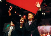 Tony Blair and Cherie Blair waving during standing ovation. Labour Party conference 2002 - John Harris - ,2000s,2002,Conference,conferences,Labour Party,Party,POL,POL politics,political,POLITICIAN,POLITICIANS,Politics,SPEAKER,SPEAKERS,speaking,SPEECH,waving