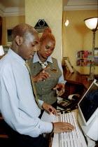 Hotel workers at Hotel reception, Grand Hotel Birmingham. Shop steward with member. - John Harris - 02-11-2002