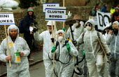 Anti war protest, led by spoof weapons inspectors from Gloucestershire. USAF Fairford air base. - John Harris - 14-12-2002