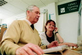 Tutor with GPMU member Albert, TUC learning services at the GPMU Learning Zone Nottingham - John Harris - 25-02-2003