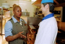 Hotel workers, Grand hotel Birmingham. Shop steward with member. - John Harris - 02-11-2002