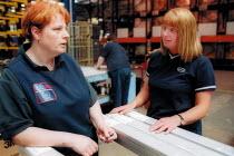 Shop steward talking to member on the shopfloor at Link 51 Brierley Hill. - John Harris - 16-10-2002