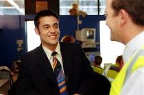 Shop steward at Serviceair airside operations talking to a GMB member, Birmingham Airport. - John Harris - 02-07-2002