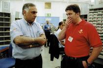 Trades Union representative talking with CWU member, Royal Mail Centre Birmingham. - John Harris - 19-08-2002