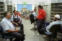 Trades Union representative talking with CWU members, Royal Mail Centre Birmingham. - John Harris - 19-08-2002