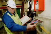 Amicus union organisers making a Health and Safety Inspection, checking safety equipment and protective clothing & goggles. Rhodia Chemicals Oldbury - John Harris - 23-09-2002