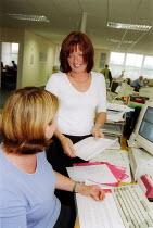 MSF Trades Union organiser talking to a member in the office. Rhodia Chemicals Oldbury - John Harris - 23-09-2002