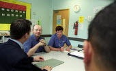 USDAW representative with an employee accussed of theft in a disciplinary meeting with management. Tesco Warwick. Posed. - John Harris - 27-08-2002