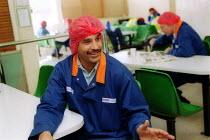 Works convener recruiting worker in the canteen. British Bakeries, Birmingham - John Harris - 27-08-2002