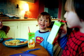 Boys eating pizza and chips, drinking cartons of fruit juice. - John Harris - ,2000s,2003,a,at,BOY,boys,branding,BREAK,c,CARE,carer,carers,carton,child,Child Care,childcare,CHILDHOOD,CHILDMINDING,children,chip,chips,diet,diets,DINNER,dinners,DINNERTIME,drink,drinking,early year