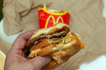 Eating a Big Mac and regular fries. - John Harris - 23-07-2003