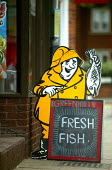 Fresh fish sign outside a Fish and Chip shop. - John Harris - 2000s,2003,and,away,Chips,cod,communicating,communication,diet,diets,EBF economy,eni environmental issues,Fish,fisheries,fisherman,fishermen,fishery,FISHES,fishing,Fishing Industry,food,FOODS,gastrono