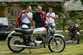 Motorcyclists admiring a vintage BSA motorcycle on the village green, Whichford Village Fete, The Cotswolds. August Bank Holiday. - John Harris - 2000s,2003,ACE culture,admiration,appreciating,Bank,BANKS,bashing,bike,biker,bikers,bikes,british,communities,community,Cotswold,country,english,enjoying,enjoyment,Enthusiast,festival,FESTIVALS,fun,ho