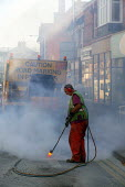 Worker from contractor Durolas removing road markings. - John Harris - 17-09-2003