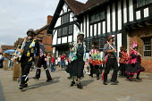Morris dancers performing for tourists by Shakespeares Birthplace Stratford on Avon Warwickshire. - John Harris - 20-09-2003