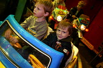 Little boy having fun on a ride at the Stratford Mop Fair. Stratford on Avon Warwickshire. - John Harris - 10-10-2003