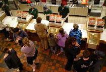 Customers buying at McDonalds fast food restaurant. - John Harris - 10-10-2003