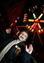 Little boy having fun at the Stratford Mop Fair. Stratford on Avon Warwickshire. - John Harris - 10-10-2003