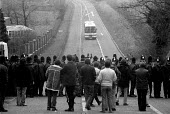 Police line and pickets from Wales as a coach full of scabs arrive for work, the pickets could not speak to the working miners. Miners Strike Daw Mill Colliery Warwickshire. - John Harris - 1980s,1984,adult,adults,breaker,breakers,breaking,CLJ,collieries,Colliery,cross,crosses,crossing,DISPUTE,DISPUTES,force,INDUSTRIAL DISPUTE,MATURE,member,member members,members,mine,MINER,Miners,MINER'
