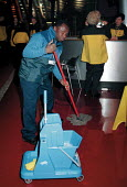 Cleaner mopping floor of Millennium Dome New Years Eve 1999/2000 - John Harris - 2000,2000s,BAME,BAMEs,black,BME,bmes,CELEBRATE,Celebrating,Celebration,CELEBRATIONS,Cleaner,cleaners,cleaning,cleansing,diversity,employee,employees,Employment,ethnic,ethnicity,floor,job,jobs,lbr,Mill