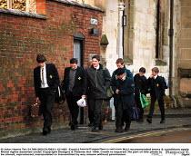 School pupils on the way to King Edward 5th Grammar school for boys, Stratford on Avon - John Harris - 2000,2000s,adolescence,adolescent,adolescents,BOY,boys,child,CHILDHOOD,children,EDU education,elite,elitism,EQUALITY,INEQUALITY,juvenile,juveniles,kid,kids,male,people,person,persons,Privilege,Privile