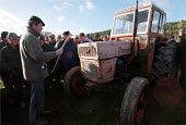 Auctioneer selling Lot 257 a tractor. Farmers buying farm machinery at an auction of goods of a farmer who has gone out of business. Shropshire. 22,000 Farmers and Agricultural workers quit farming in... - John Harris - 2000,2000s,agricultural,agriculture,auction,Auctioneer,Auctioneers,AUCTIONS,buy,buyer,buyers,buying,capitalism,capitalist,commodities,commodity,country,countryside,EBF economy business,employee,employ
