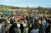 Auctioneer selling Tractor. Farmers buying farm machinery at an auction of goods of a farmer who has gone out of business. Shropshire. 22,000 Farmers and Agricultural workers quit farming in year to J... - John Harris - 10-02-2000