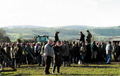 Auctioneer selling tools. Farmers buying farm machinery at an auction of goods of a farmer who has gone out of business. Shropshire. 22,000 Farmers and Agricultural workers quit farming in year to Jun... - John Harris - 10-02-2000