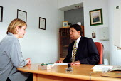 Occupational Physician with patient in consultation at work place clinic, PowerGen - John Harris - 03-03-2000