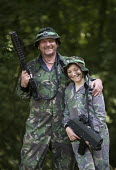 Father and son combatants at Pembrokeshire Battlefield Live war game simulation. Battlefield LIVE is an outdoor combat game using gaming guns with the latest infra-red technology as used by the Milita... - John Harris - 14-08-2010