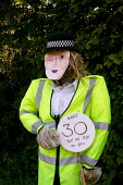 Scarecrow competition, Binton village, Warwickshire - John Harris - 2000s,2004,30,adult,adults,AUTO,AUTOMOBILE,AUTOMOBILES,AUTOMOTIVE,car,cars,COMPETITATIVE,competition,english,festival,FESTIVALS,highway,lfL lifestyle & leisure,limit,MATURE,mph,Officer,officers,PEOPLE