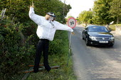 Scarecrow competition, Binton village, Warwickshire - John Harris - 2000s,2004,30,adult,adults,COMPETITATIVE,competition,english,festival,FESTIVALS,highway,lfL lifestyle & leisure,limit,MATURE,mph,Officer,officers,PEOPLE,Police,policing,road,roads,rural,Scarecrow,Scar