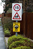 Speed limit, children playing warning and Neighbourhood Watch signs at the entrance to a private housing estate. - John Harris - 10-03-2006