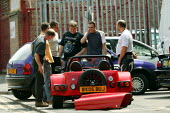 Men looking at a friends new car, Birmingham - John Harris - 14-07-2005
