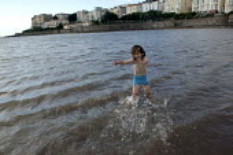 Little boy paddling in the sea. Weston Super Mare, Somerset. - John Harris - 20-08-2005