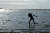 Little boy wading in the sea. Weston Super Mare, Somerset. - John Harris - 20-08-2005
